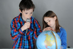Lecture. Children giving a lecture on our earth stock photos