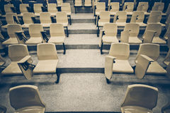 Lecture chairs in a class room. With stair path in the middle of a class Royalty Free Stock Photography