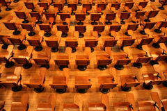 Lecture Hall. Empty wooden seats in an lecture hall in a university Stock Image
