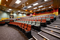 Lecture hall with colorful chairs Stock Photos