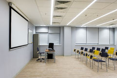 Lecture hall. Empty bright lecture hall with chairs. Grey black yellow tones Royalty Free Stock Photos
