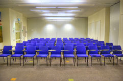 Lecture Hall. Rows of blue chairs in a modern high-tech lecture hall Stock Photos