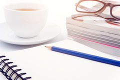 Lecture note. Cup of coffee on with book and Pencil on white background Stock Photo