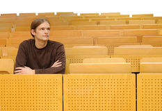 Lecture room. Student sitting in a lecture room stock image