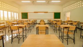 Lecture room or School empty classroom with desks and chair iron. Wood for studying lessons in high school thailand, interior of secondary education, with royalty free stock photo