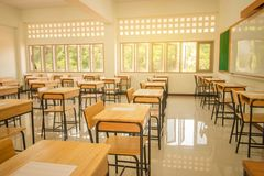 Lecture room or School empty classroom with desks and chair iron stock photos