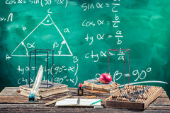Lecture of trigonometry in school. On old wooden table Stock Photo