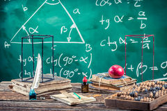 Lecture of trigonometry in school. On old wooden table Royalty Free Stock Photos