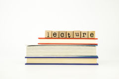 Lecture word on wood stamps and books Royalty Free Stock Image