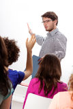 Lecturer discussing with students stock photo