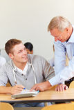 Lecturer helping a student Royalty Free Stock Images