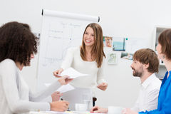 Lecturer or in house trainer handing out notes Stock Photos