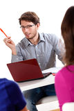 Lecturer leading a workshops. A young attractive lecturer leading a workshops with students Royalty Free Stock Image