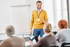 Lecturer makes a business presentation Royalty Free Stock Photo