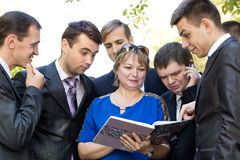 Lecturer reviews the student's homework Stock Photos
