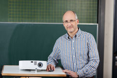 Lecturer with a slide projector Stock Photography