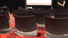 Lecturer speaking in empty auditorium stock video footage