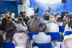 Lecturer Speaking In front of the Large Group of People. Stock Image