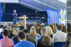 Lecturer Speaking In front of the Large Group of People. Royalty Free Stock Photography