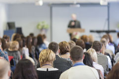 Lecturer Speaking In front of the Large Group of People Stock Image