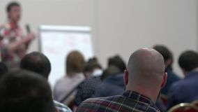 Lecturer speaking to his class in the lecture hall at the university. Skinhead stock footage