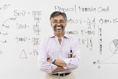 Lecturer Standing With Arms Crossed Royalty Free Stock Photography