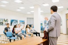 Lecturer talking on a conference room background. Business partnership concept. Copy space. royalty free stock photo