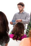 Lecturer talking to students Royalty Free Stock Images