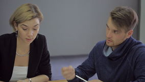 Lecturer at the University accepts students exams. Beautiful nice modern professor of electrical engineering, solar energy and wind energy woman in university stock video