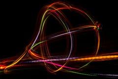 从LED光的被弄脏的抽象线 库存图片