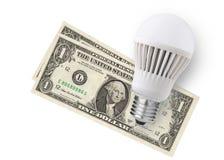 LED电灯泡和金钱 免版税库存图片