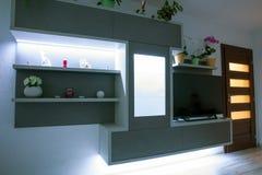 Led backlight in furniture. Modern designed furniture in livingroom with led backlight stock photography