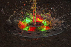 LED Backlight jet fountain at night Royalty Free Stock Photo