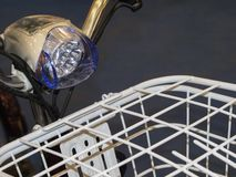 LED Bicycle Light. Bicycle LED headlight fixed on the bicycle handlebar near the front trunk royalty free stock image
