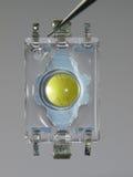 LED blanco. Base amarilla Imagen de archivo libre de regalías