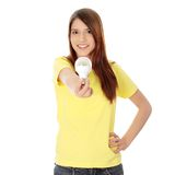 Led bulb. Happy young woman holding led bulb Stock Photo