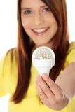 Led bulb. Happy young woman holding led bulb Royalty Free Stock Photos