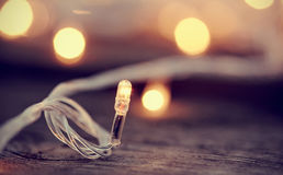 LED bulb against the background of fires of a Christmas garland. Stock Images
