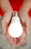 LED bulb - Energy in our hand2 Stock Photo