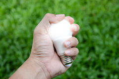 LED bulb - Energy in our hand with lighting Stock Photos