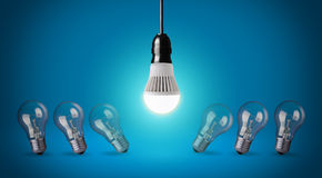 LED bulb. Glowing LED bulb and simple light bulbs Royalty Free Stock Images