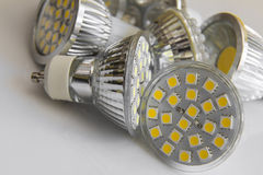 Led bulb GU10 with 3-chip SMD warm white. In the back chilled Royalty Free Stock Photography