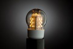 Led bulb light. Working led bulb light on grey background royalty free stock image