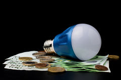 LED Bulb with money Stock Photography