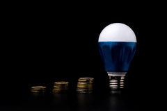 LED Bulb with money Stock Photos