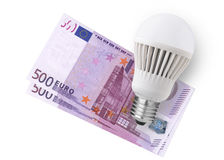LED bulb over emoney Royalty Free Stock Photography