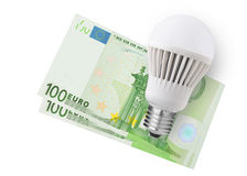LED bulb over money Stock Photo
