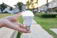 LED Bulb - saving technology in our hand Stock Images