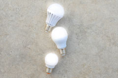 LED Bulbs on the concrete floor Stock Image
