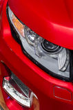 Led car headlight. Headlight with led lamps and hood of red sport modern car Royalty Free Stock Image